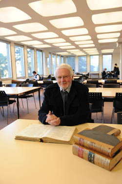 Associate Professor Max Liddell in the Law Library at Monash Clayton